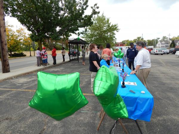 A coalition of Ohio groups affiliated with Wright State's Medicaid Outreach Consortium gathered in a health center parking lot Tuesday to talk to the public about the Affordable Care Act Marketplace.