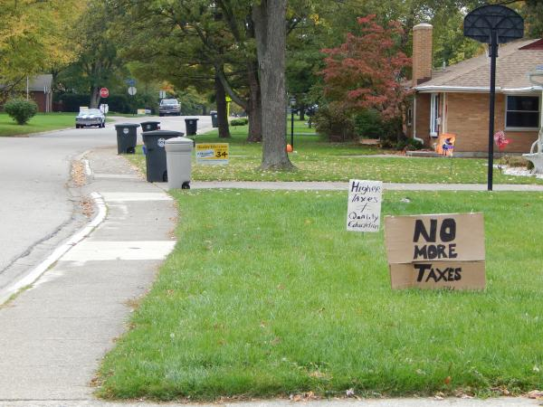 Just a few blocks from the Centerville Board of Education office, neighbors weigh in on opposite sides of the school levy debate.