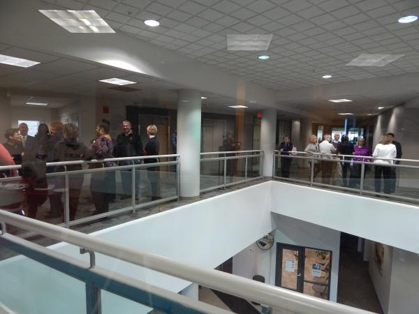 Staff and supporters gather on the 2nd floor of the Wright Health Building, where the new ARC medical center is located. The pharmacy set up to help fund the center is on the first floor.