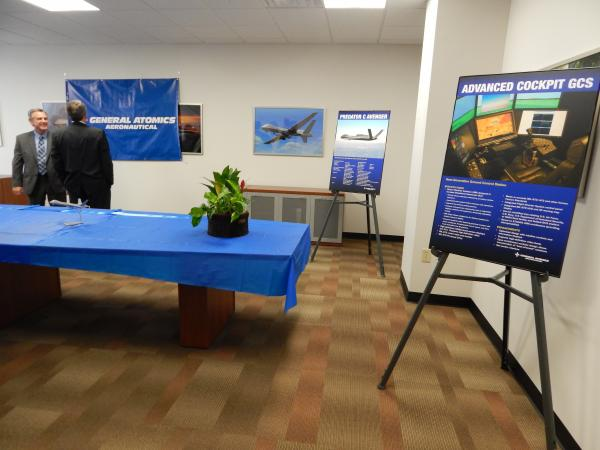 Employees of General Atomics Aeronautical, the manufacturer of Predator and Reaper drones, talk in the company's new Beavercreek office.