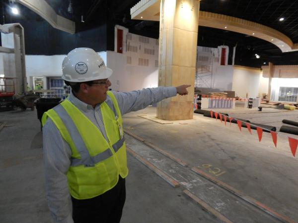 Gary DeWitt, the general manager of the new Hollywood Gaming racino in north Dayton, points out features of the main gaming room.