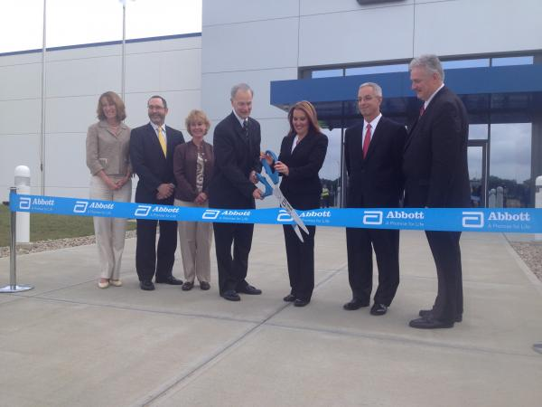 Officials prepare to cut the ribbon on the new Abbott facility in Tipp City, Ohio.