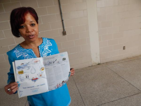 Karen Thomas holds up a brochure advertising Dayton's delicious water.