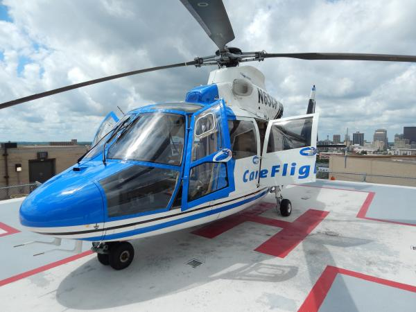 The CareFlight emergency helicopter on the roof of Miami Valley Hospital. Transportation is one of the many surprise expenses that can come out of an ER visit.
