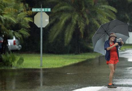 A Woman Takes Photo Of Flooded Streets In The S Acres St Petersburg