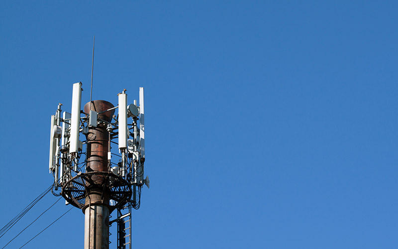 This 2013 photo shows a tower with a cellular telephone antennas and electronic communications equipment.