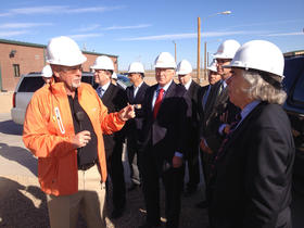Plant supervisor Danny Allison talks with U.S. Energy Secretary Ernest Moniz and other visitors at the plant's opening event in October.