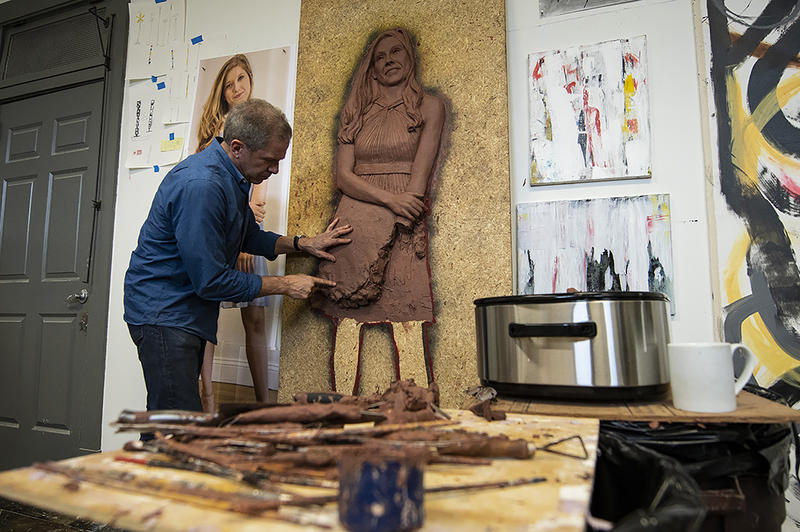 Tom Corbin sculpts a bas-relief in his studio, a converted firehouse in Rosedale, Kansas.