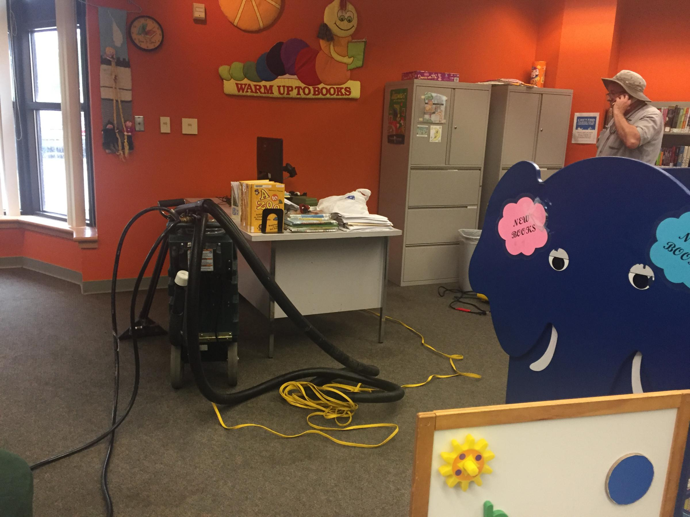 For The First Time In 22 Years Kansas City Public Library Is Electrical Wiring Training Books A Maintenance Worker Tries To Dry Out Carpet Of Childrens Corner At Waldo On Tuesday After It Flooded Again