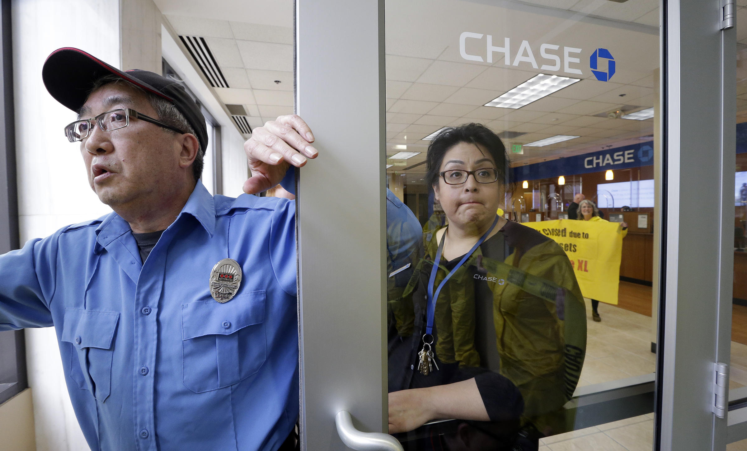 Climate Activists Target JPMorgan Chase Banks In Seattle | KNKX