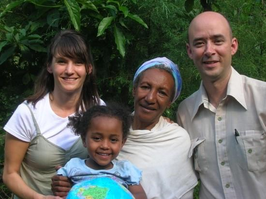 Meri Putnam and her Ethiopian grandmother when her parents were in Ethiopia to adopt her. Meri Putnam, her Ethiopian grandmother, and her parents, Kelly Ryan and Mark Putnam. This photo was taken when Ryan and Putnam were in Ethiopia to adopt her.