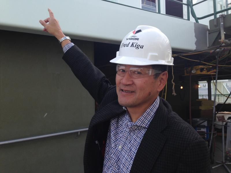 Vigor Industrial's VP of government relations, Jack Kiga, points to the governor's welding job.