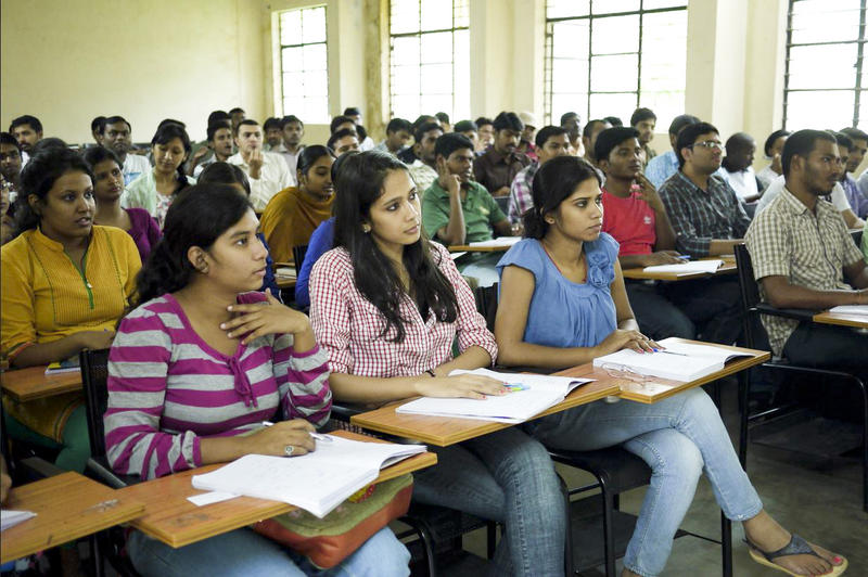 Students sit in a computer science class taught by professor Chakravarthy Bhagavati at the University of Hyderabad.