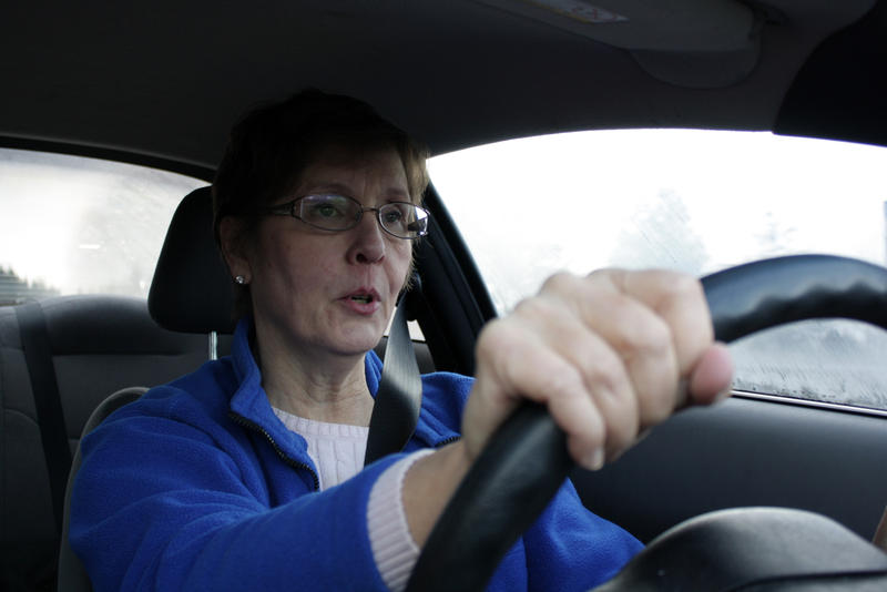Cynthia Ulrich of Stop 405 Tolls looks unhappy as she prepares to enter the toll lane for the first time.
