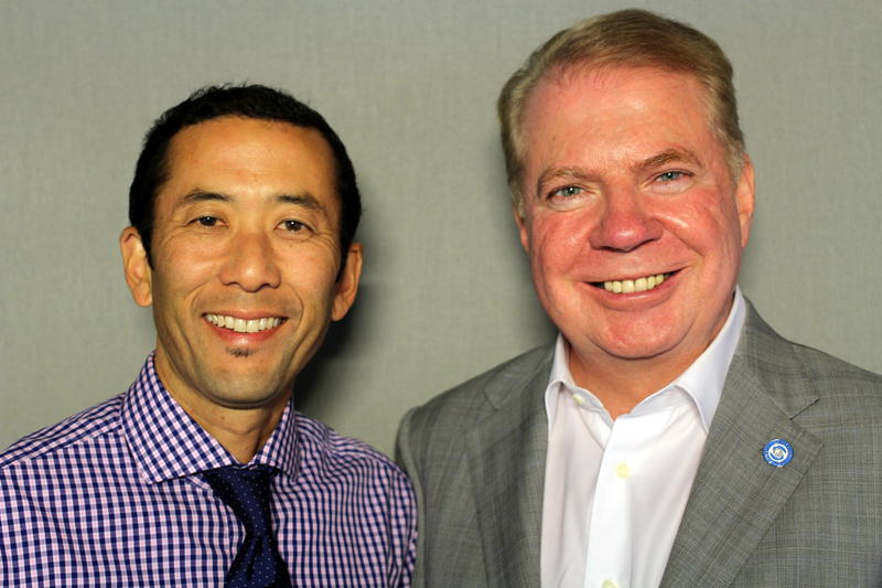 Michael Shiosaki and Mayor Ed Murray at a 'StoryCorps' booth in Seattle.
