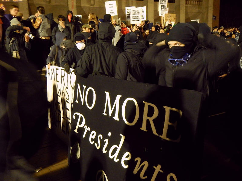 Protesters crowd into the University of Washington's Red Square on Friday, January 20, 2017 during a speech by Breitbart editor Milo Yiannopoulos.
