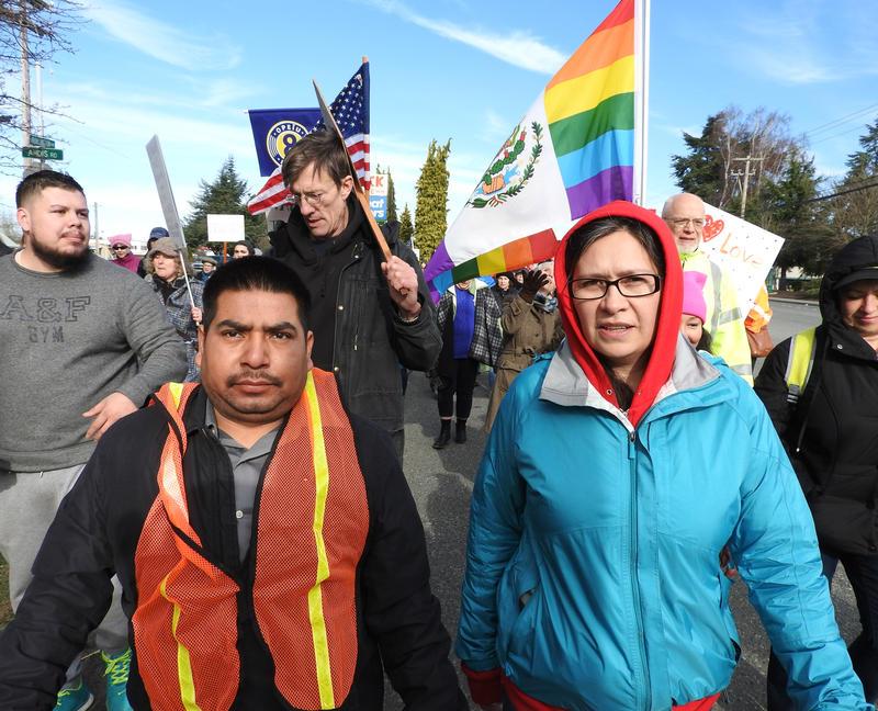 Felimon Pineda (left), vice president of the union Familias Unidas por La Justica, marches from Burlington toward Mount Vernon on Sunday.