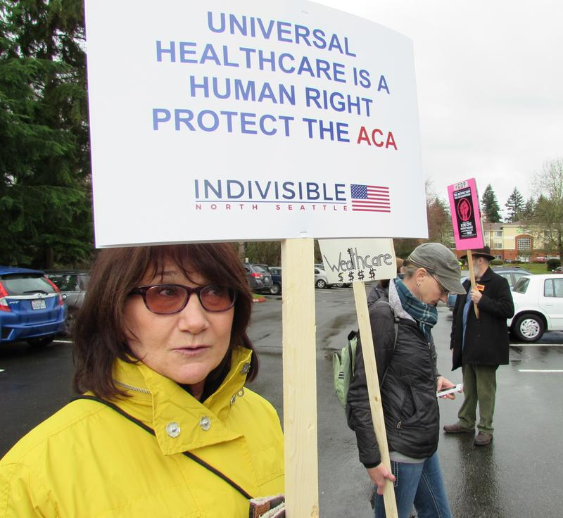 Christine Mathews says she couldn't afford health insurance without the ACA subsidies. She was at a rally last month outside  Congresswoman Suzan DelBene's district office in Bothell.