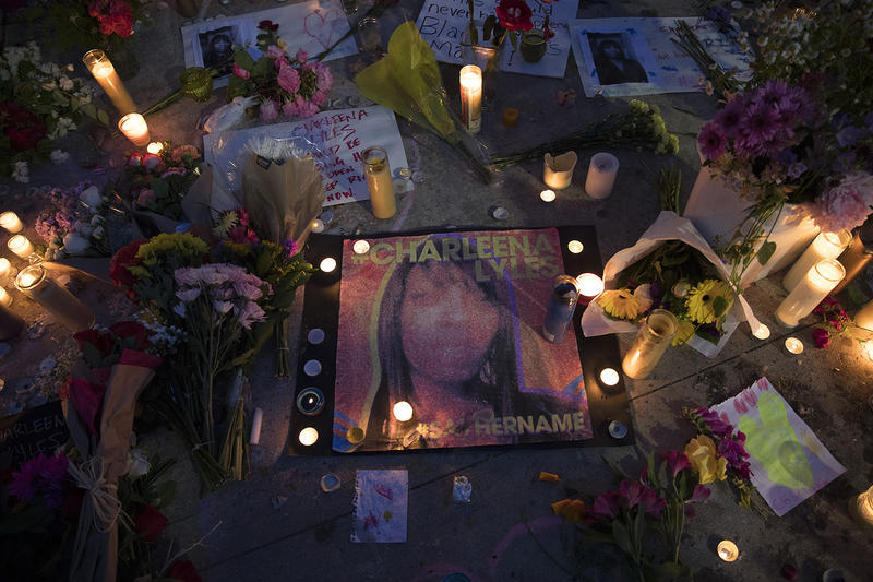 Candles surround a photograph of Charleena Lyles after a vigil was held at Solid Ground Brettler Family Place on Tuesday, June 19, 2017, in Seattle, Washington.