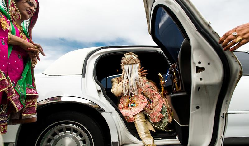 Kanwalpreet steps out of a white limo. He and Madhuri were married at the Gurudwara Singh Sabha of Washington in Renton.