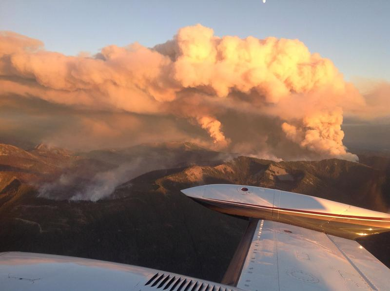 Smoke billows over the Jolly Mountain Fire near Roslyn, Washington, on Friday, Sept. 1, in this aerial image.