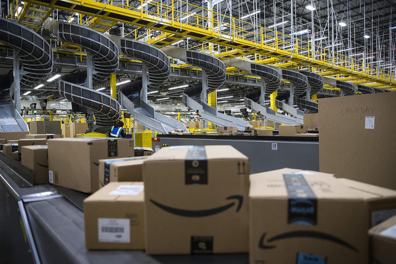 Boxed items are shown on conveyer belts leading to docks where they will be loaded onto trucks at an Amazon fulfillment center on Friday, November 3, 2017, in Kent.