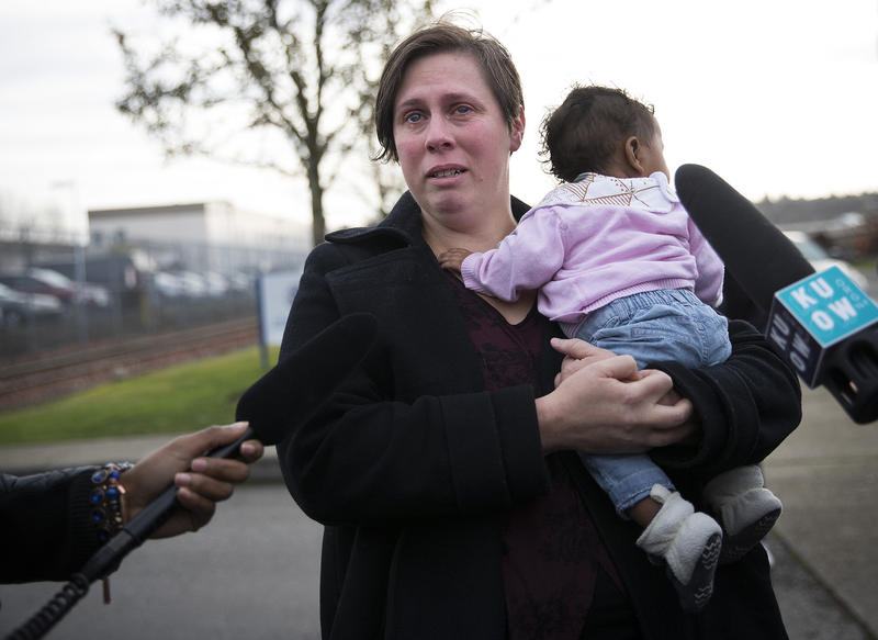 Rebecca Fatty becomes emotional while holding her 4-month-old daughter Sunkarah as she speaks to the press after her husband Bangally Fatty was denied bond on Wednesday, November 29, 2017, at the Northwest Detention Center in Tacoma.