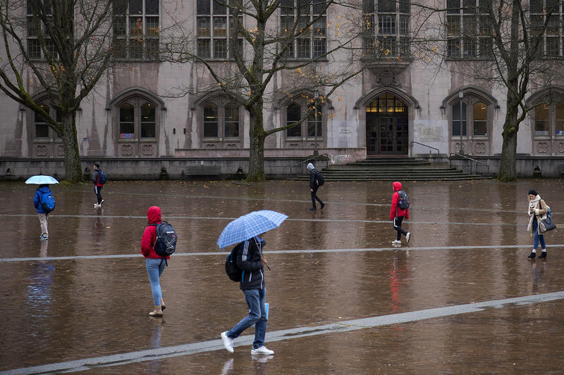Students walk in front of Gerberding Hall on Thursday, November 16, 2017, on the University of Washington campus in Seattle.