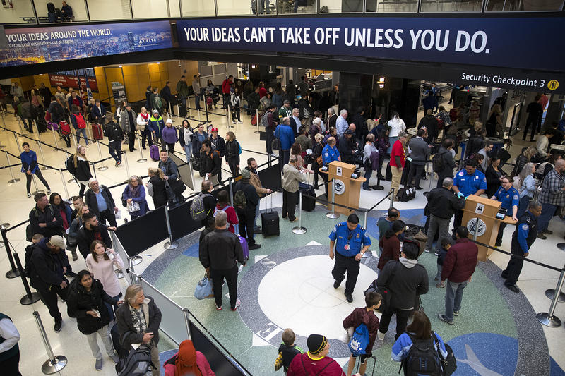 Passengers make their way through security at Seattle-Tacoma International Airport.