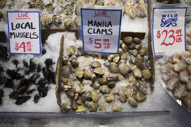 Oysters, mussels and clams are shown on Tuesday, January 9, 2018, at City Fish Co. at Pike Place Market in Seattle.