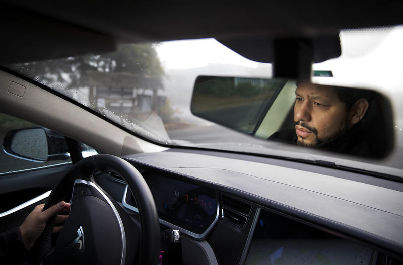Nesib CB Shamah drives his Model S Tesla on Monday, December 11, 2017, near his home in Seattle.