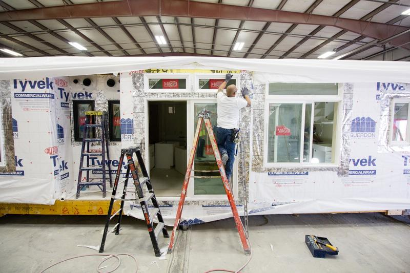 A worker in Boise puts together an apartment bound for Seattle.