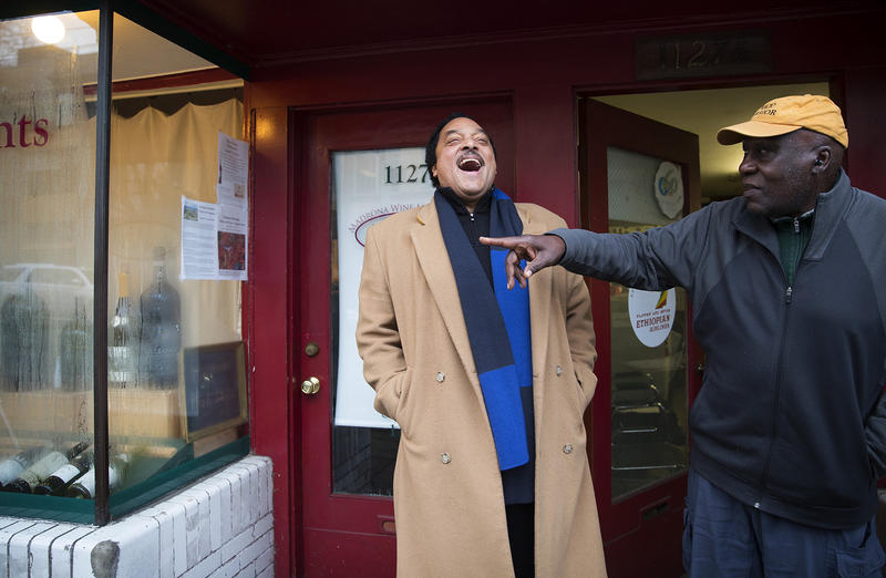 Elmer Dixon, left, laughs with Ben Abe, right, the current owner of the space where the Seattle Black Panther Party had their first office, while reminiscing about the location, on Wednesday, January 10, 2018, on 34th Avenue in Seattle.