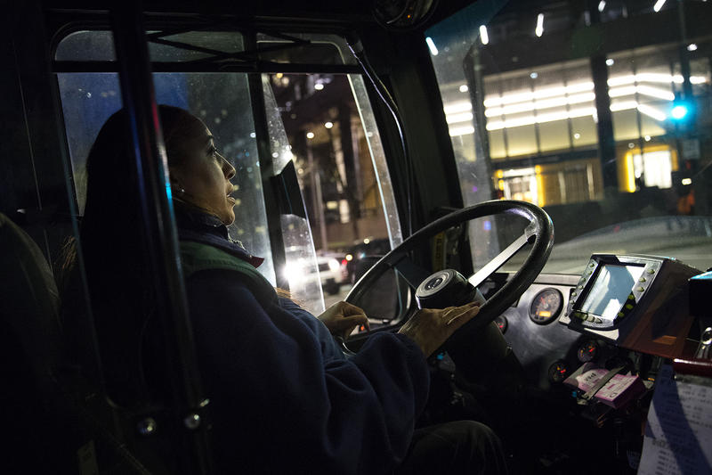 Nichole Fabre drives the RapidRide E Line bus up and down Aurora. On a recent weekday morning, she started driving around 3:55 a.m., beginning in Seattle.