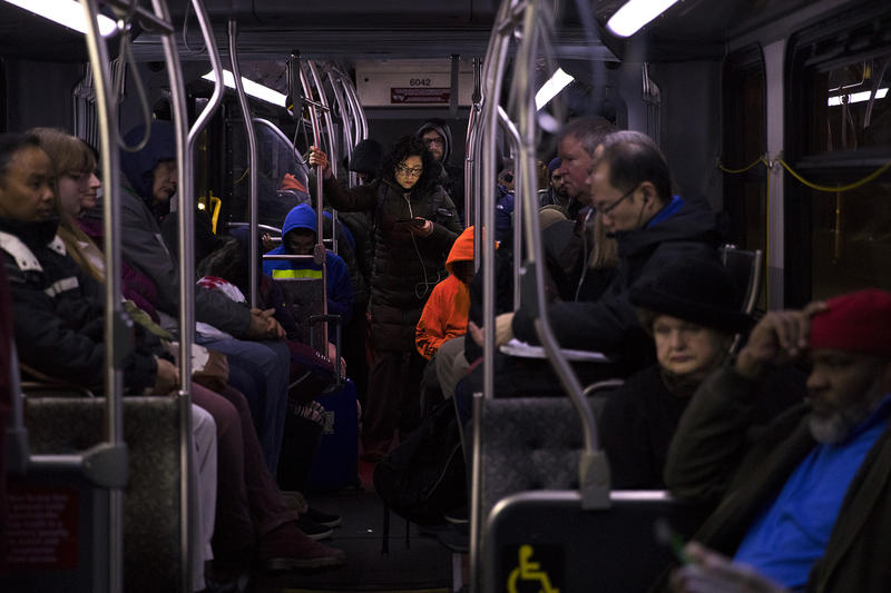 Commuters ride the E Line bus southbound on Aurora Avenue North, around 5:30 a.m., on Wednesday, April 11, 2018, in Seattle.