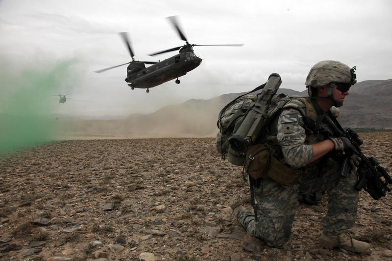 U.S. Army Spc. Kevin Welsh provides security before boarding a CH-47 Chinook helicopter after completing a mission in Chak valley in the Wardak province of Afghanistan on Aug. 3, 2010.