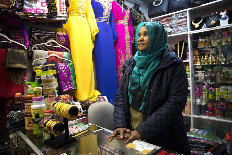 Dahaba Omar poses for a portrait on Monday, April 16, 2018, behind the counter of her store inside the Bakaro Mall, just south of Tukwila's border in SeaTac.