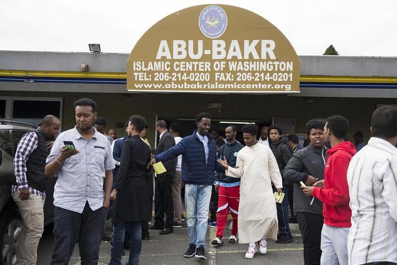 Men exit the Abu-Bakr Islamic Center after prayer on Friday, April 20, 2018, in Tukwila.
