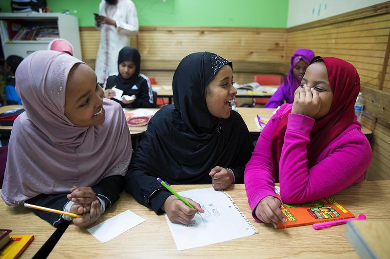 From left, 4th-grade students Nadiya Abdi, Nusaybah Jaranow and Yusra Ahmed laugh during class on Friday, April 20, 2018, in Tukwila.