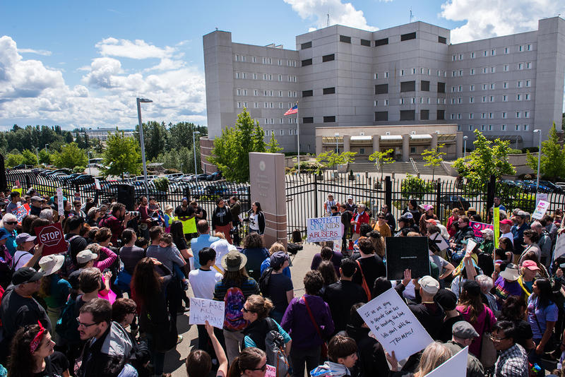 Protesters occupy the sidewalk and into the street during the Solidarity Day protest outside of the Federal Detention Center in SeaTac.