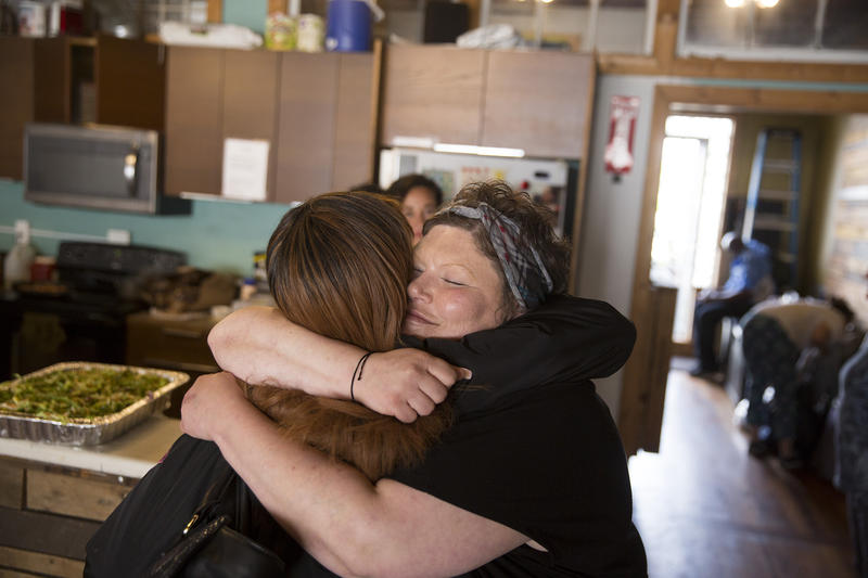 Ericka Frodsham hugs a friend at Aurora Commons, a homeless resource center on Aurora Ave, in Seattle on May 9, 2018. Frodsham often utilized the services at Aurora Commons when she was living on the streets. Now she volunteers there.