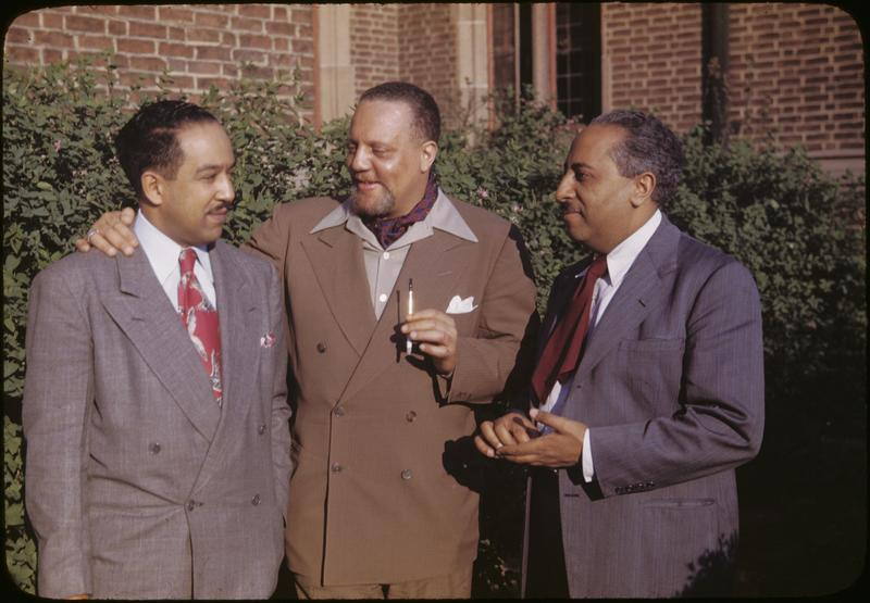 Horace Cayton Jr., center, as an adult. Cayton worked many jobs before becoming an esteemed sociologist in Chicago - longshoreman and Seattle's first black deputy, among others.