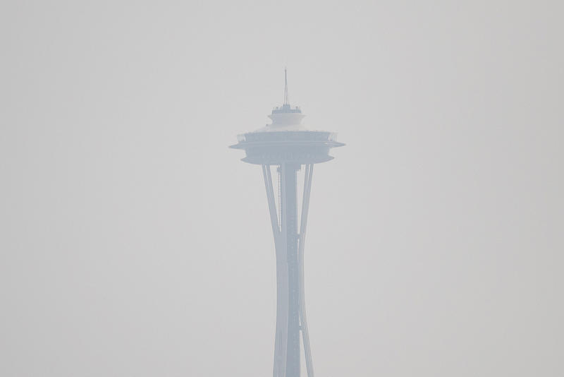Forest fire smoke obscures the Space Needle on Tuesday.