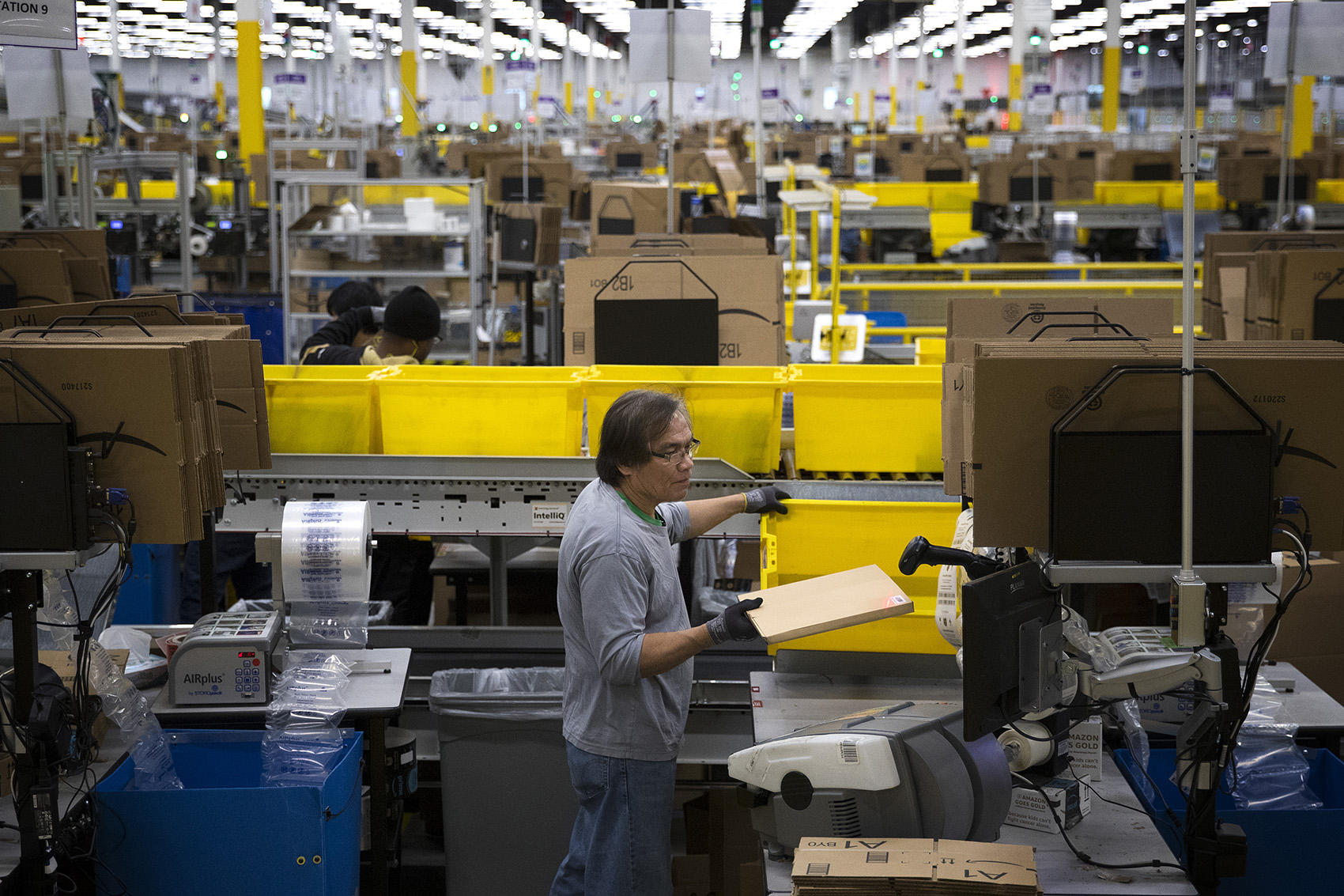 As robots take on more work, Amazon invests in warehouse