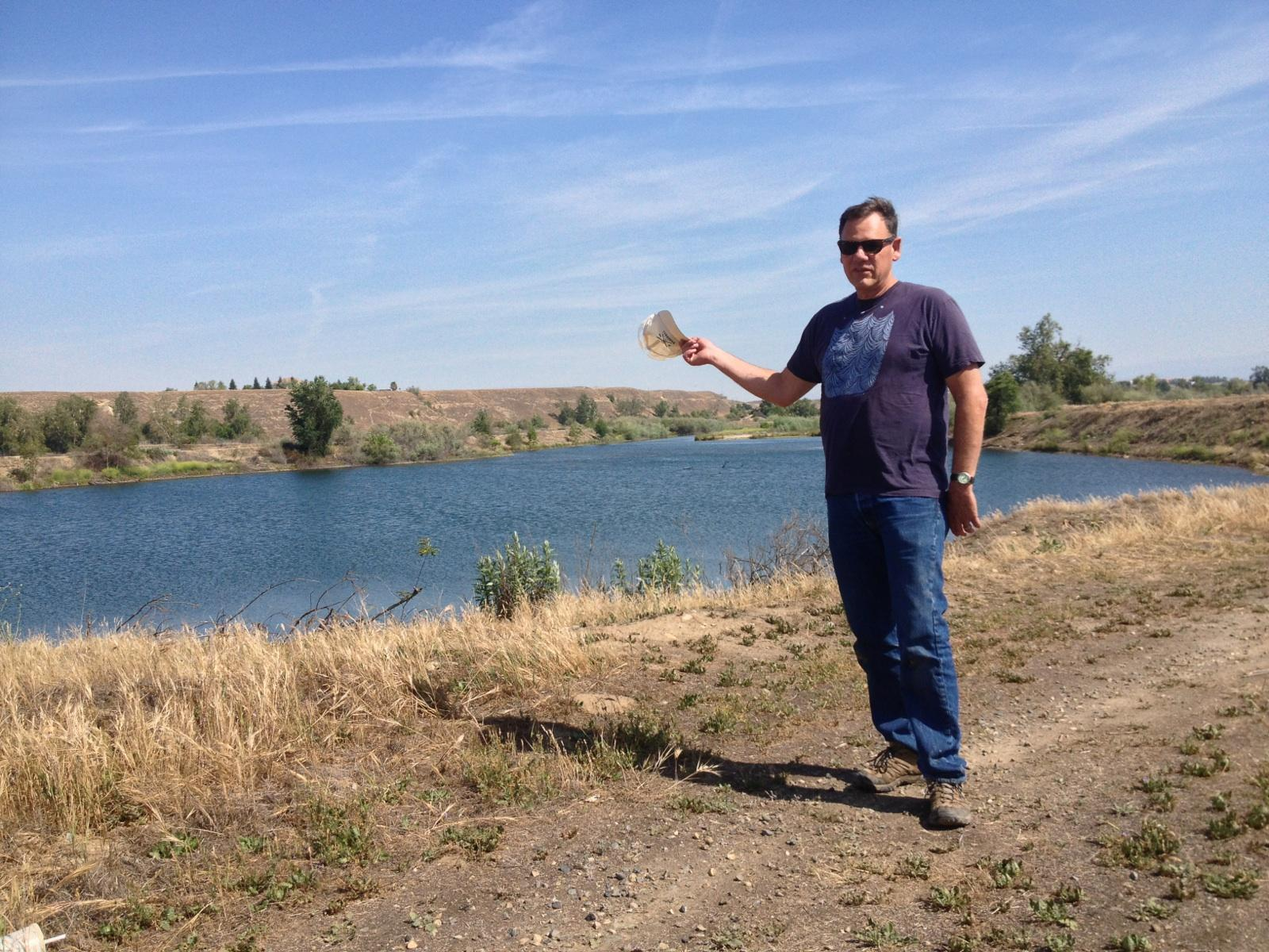 Koehler standing next to what will be a bass fishing pond at River West.