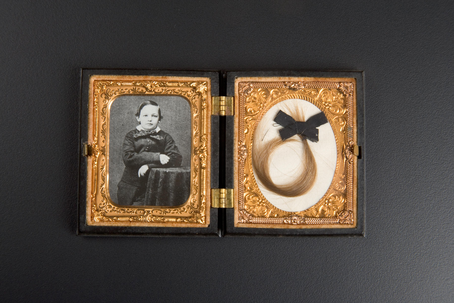 8f9fe10fffb54 A photo of Willie Lincoln and a lock of his hair, one of 1,400 items in the  Taper Collection. Willie died in the White House during Lincoln's  presidency.