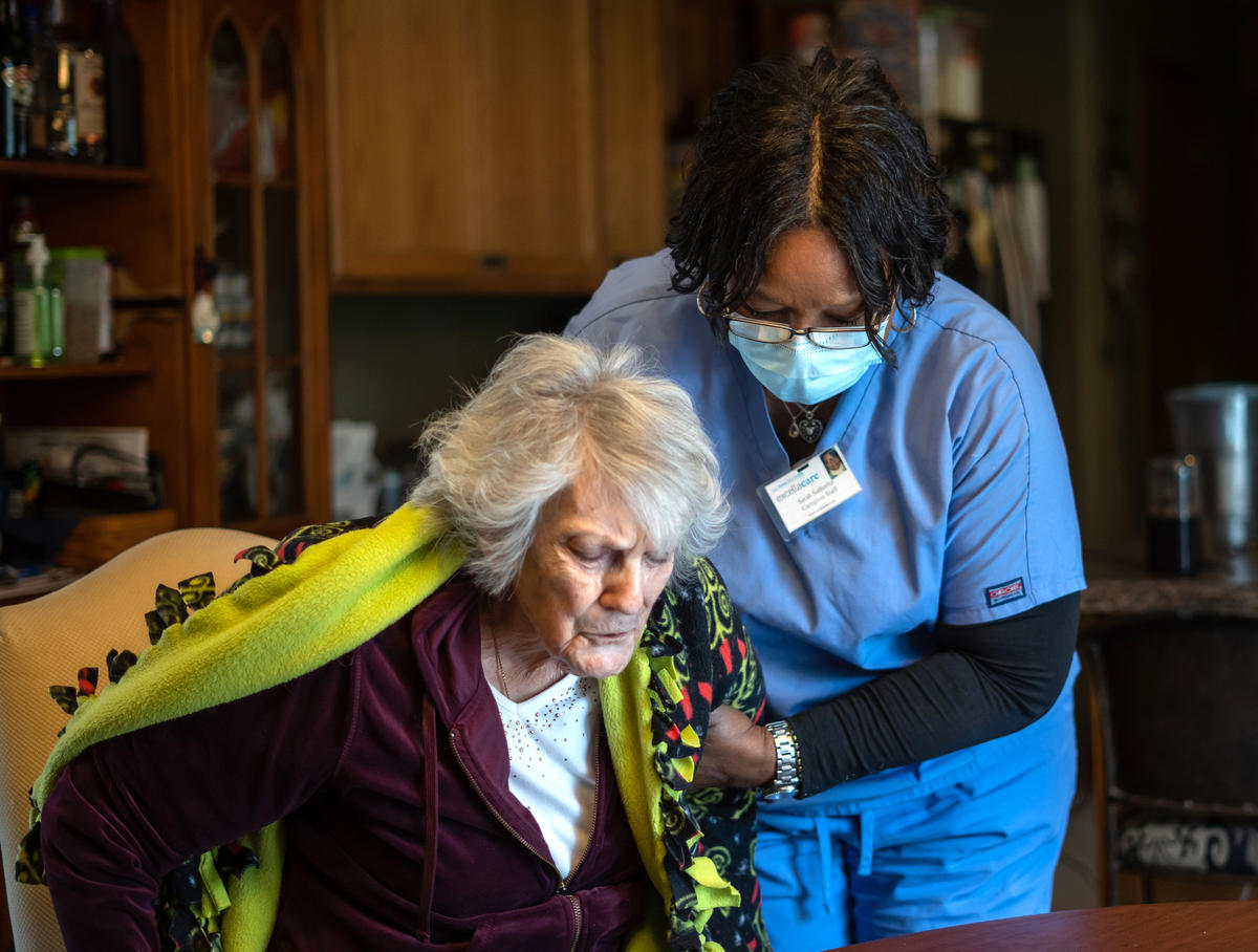 Direct care worker helps her client.