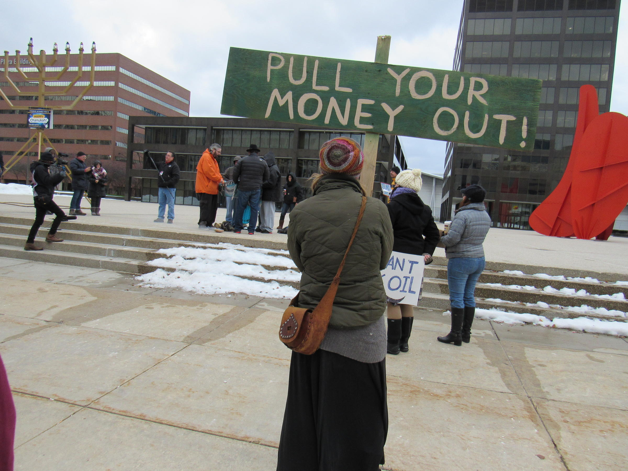 Protestors urge Chase bank customers in Grand Rapids to move money