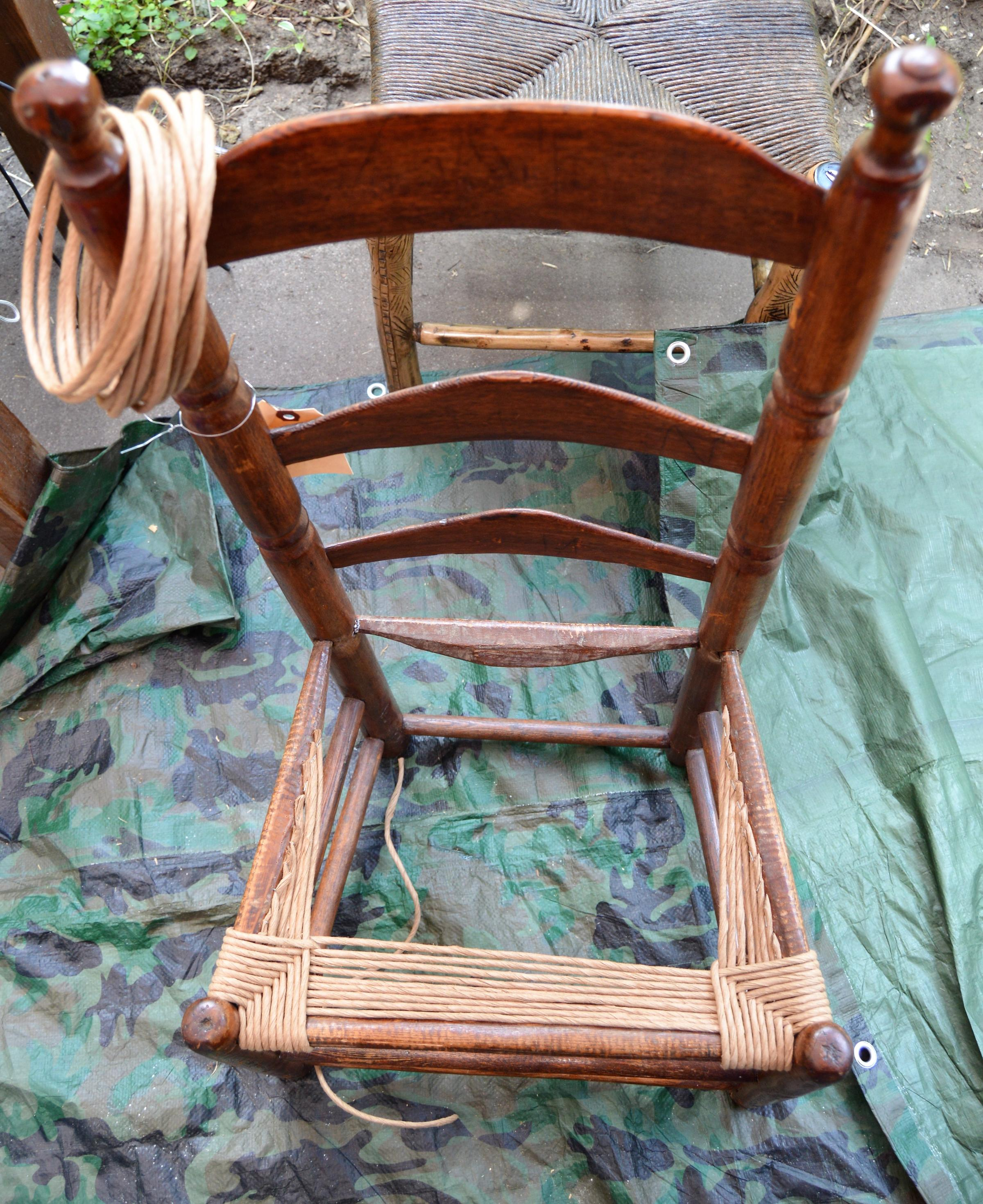 A Chair Bottom Being Re Weaved.