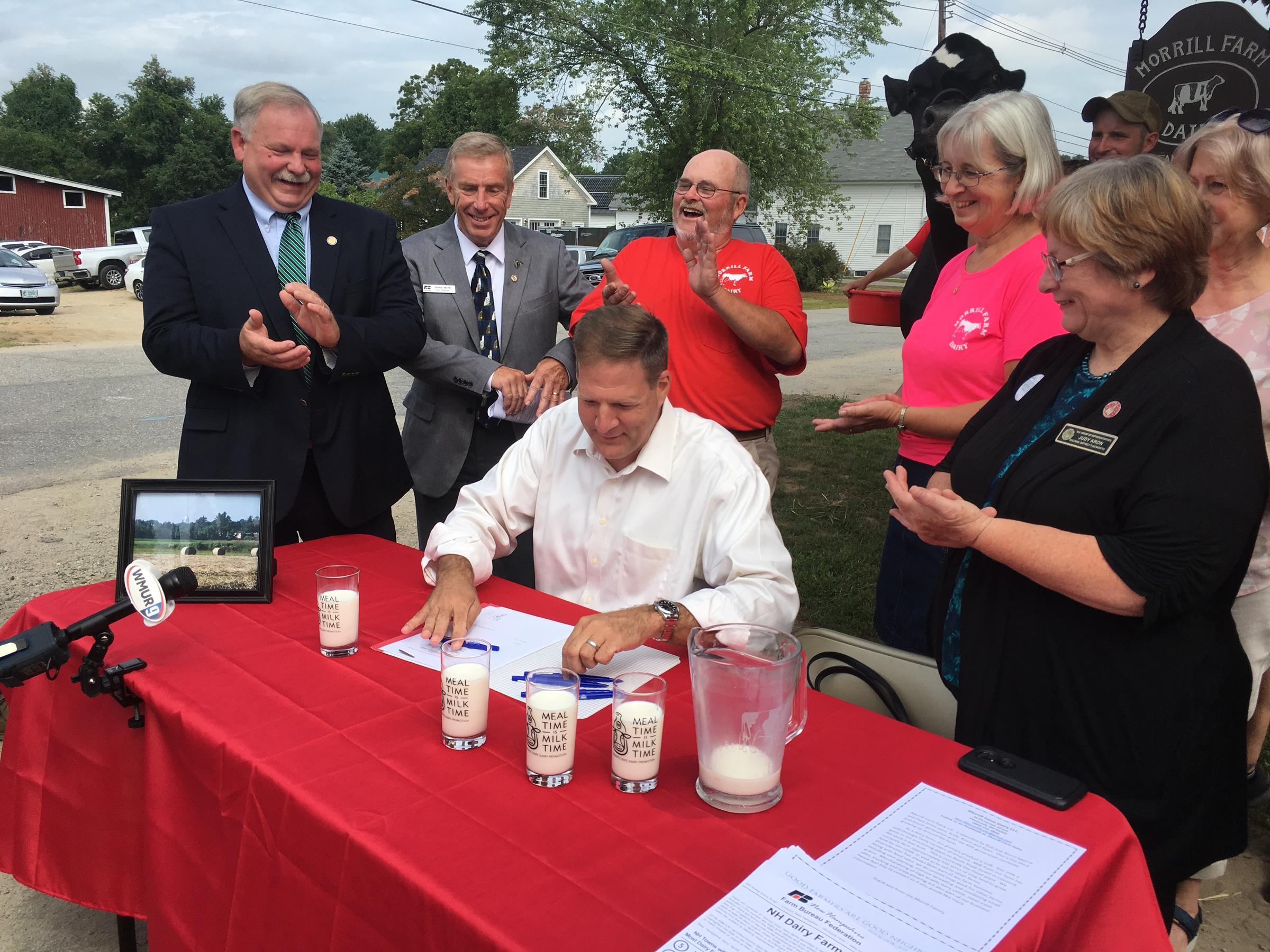 Sununu Signs Dairy Premium Fund Bill | New Hampshire Public